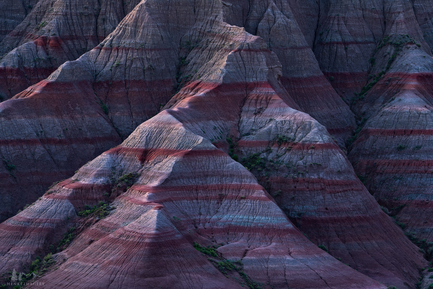 Another striking example of some the unique geology in Badlands Nat'l Park. Unlike some mountain ranges like the Rockies, that...